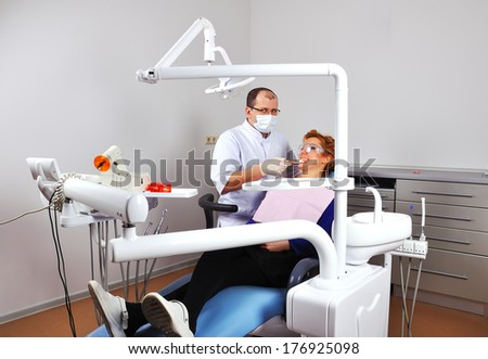 Dentist shows how to properly care for your teeth - stock photo
