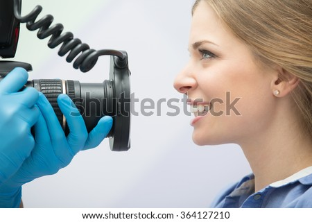 Dentist with camera and patient - stock photo