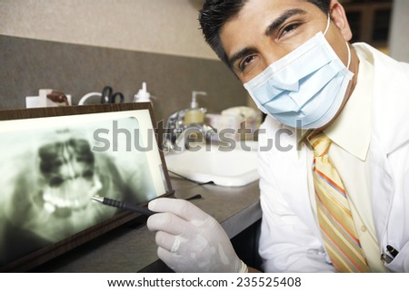 Dentist with X-Ray - stock photo