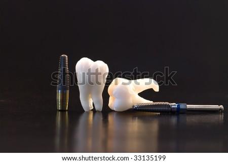 Dentistry. Wisdom teeth and titanium implant - stock photo