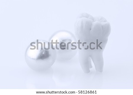 Dentistry. Wisdom tooth and natural pearls - stock photo