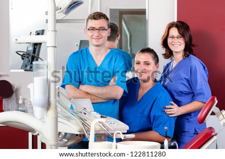 Dentists looking at the viewer standing side by side