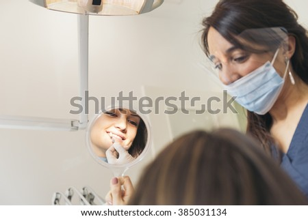 Dentists with a patient during a dental intervention. Dentist  Concept - stock photo