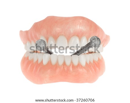 Dentures biting on nails (tough as nails) isolated on white