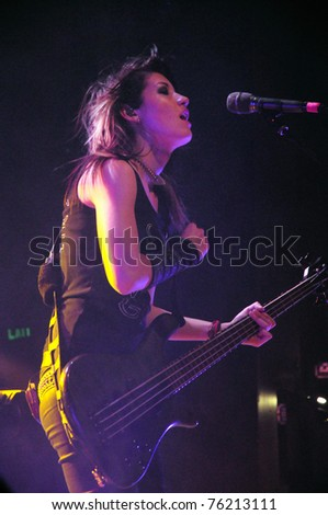 DENVER - APRIL 21:	Bassist Emma Anzai of the Alternative Rock band Sick Puppies performs in concert April 21, 2011 at the Ogden Theater in Denver, CO.