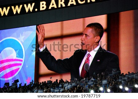 DENVER - AUG 28: Democratic presidential candidate Barack Obama speaking at Invesco Field at Mile High Stadium in Denver, Colorado, on August 28, 2008, reflected on screen. - stock photo
