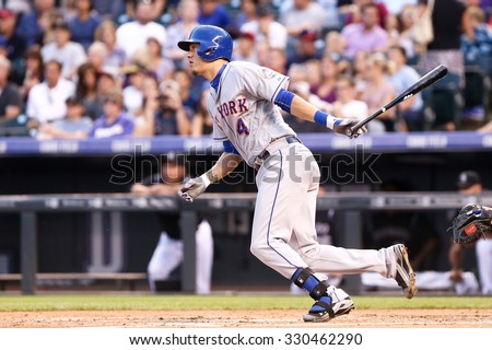 DENVER-AUG 21: New York Mets infielder Wilmer Flores swings a pitch during a game against the Colorado Rockies at Coors Field on August 21, 2015 in Denver, Colorado. - stock photo