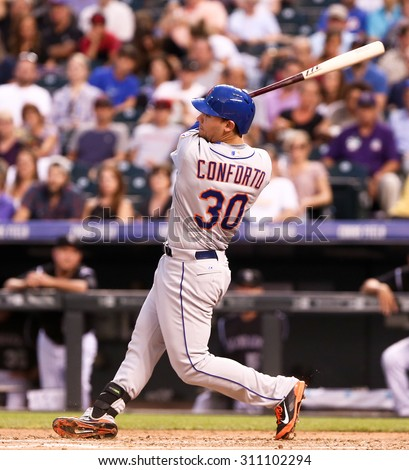 DENVER-AUG 21: New York Mets outfielder Michael Conforto swings at a pitch during a game against the Colorado Rockies at Coors Field on August 21, 2015 in Denver, Colorado. - stock photo