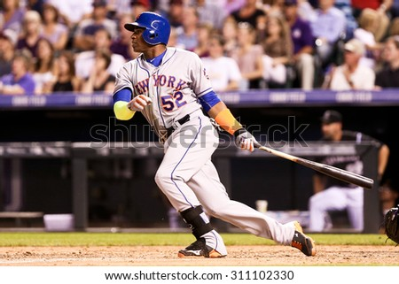 DENVER-AUG 21: New York Mets outfielder Yoenis Cespedes swings at a pitch during a game against the Colorado Rockies at Coors Field on August 21, 2015 in Denver, Colorado. - stock photo