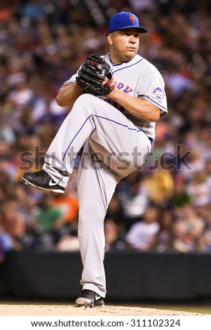 DENVER-AUG 21: New York Mets pitcher Bartolo Colon pitches during a game against the Colorado Rockies at Coors Field on August 21, 2015 in Denver, Colorado. - stock photo