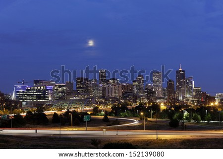 DENVER, COLORADO - AUG 20: Denver skyline at dusk on August 20, 2013. Denver is the capital of Colorado also has nicknamed the Mile-High City because the elevation is exactly one mile above sea level. - stock photo