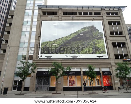 DENVER, COLORADO - JULY 7: Apple Iphone 6 camera ad on the side of building with Loft store on bottom floor in Denver, Colorado.  Iphone is the most used camera in the world.  July 7, 2015. - stock photo