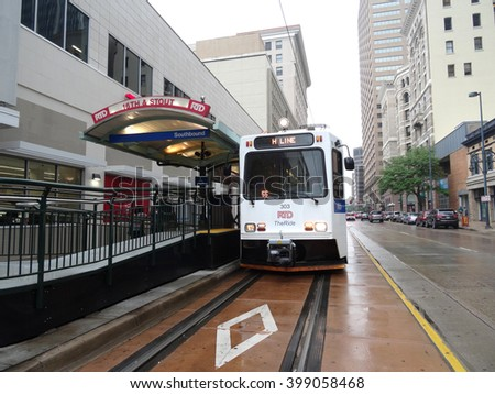 DENVER, COLORADO - JULY 7: RTD - The Ride - H Line light rail stops at 16th and Stout station on a rainy day in Denver, Colorado on July 7, 2015. - stock photo