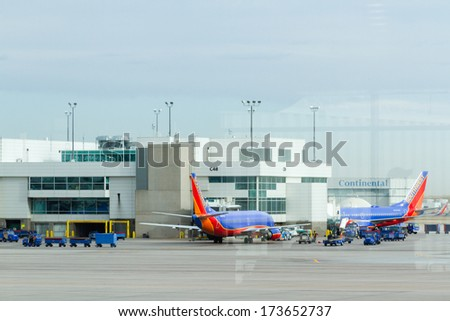 Denver, Colorado-March 29, 2013: Parked airplane at the terminal.