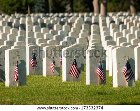 Denver, Colorado-May 28, 2012: Endless row of white marble gravestones continues above hilltop at the Fort Logan National Cemetery in Denver, Colorado.