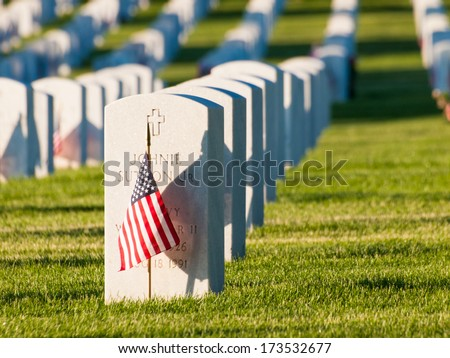 Denver, Colorado-May 27, 2012: Endless row of white marble gravestones continues above hilltop at the Fort Logan National Cemetery in Denver, Colorado.