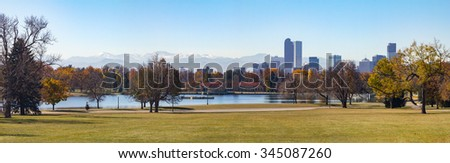 Denver, Colorado Skyline and Front Range Mountains Panoramic Landscape seen from City Park - stock photo