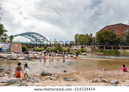 Denver, Colorado, USA-August 31, 2014. Typical summer weekend at Confluence Park in downtown Denver, Colorado. - stock photo