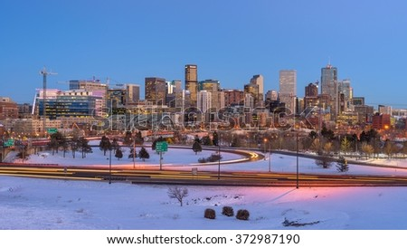 Denver, Colorado, USA - February  03, 2016: Panoramic winter evening view of Downtown Denver, looking from west side of the city, next to the busy Interstate U.S. Highway 25. - stock photo