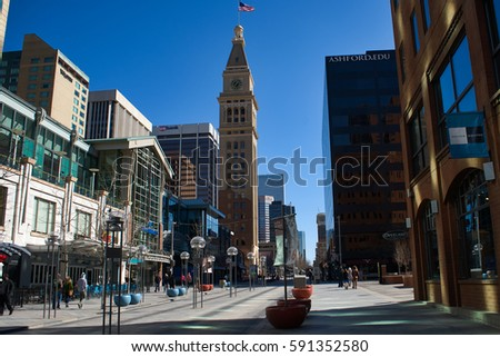 DENVER, COLORADO, USA - FEBRUARY 28, 2017: The cityscape of main shopping street 16th Street in Denver downtown with a clear blue sky.