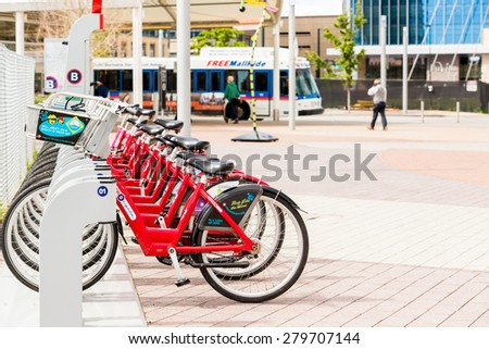 Denver, Colorado, USA-May 17, 2015. Row of red rental bikes at the Union Station in Denver, Colorado. - stock photo