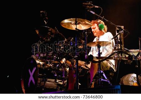 DENVER - DECEMBER 17: Drummer Rick Allen of the Heavy Metal band Def Leppard performs in concert December 17, 2002 at the Magnus Arena in Denver, CO. - stock photo