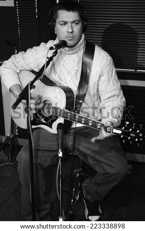 DENVERFEBRUARY 27:Vocalist/Guitarist Eric Schrody a.k.a Everlast performs in studio February 27, 2001 in Denver, CO. - stock photo