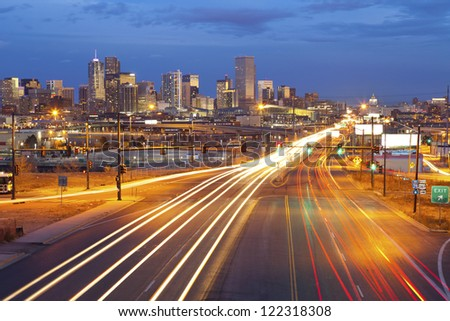 Denver. Image of Denver and busy street with traffic leading to the city. - stock photo