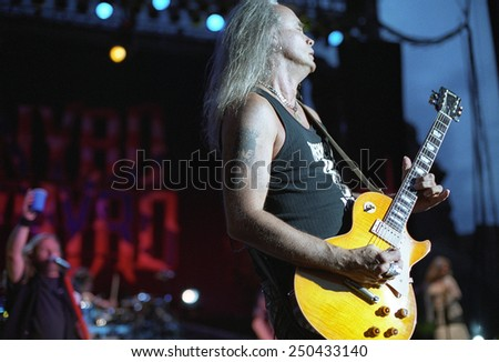DENVERJULY 02:Guitarist Rickey Medlocke of the Southern Rock Band Lynyrd Skynyrd performs in concert July 24, 2002 at Red Rocks Amphitheater in Denver, CO.  - stock photo