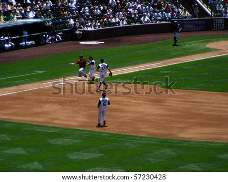 DENVER - JUNE 29: Craig Biggio of the Houston Astros slides safely into first base in a game at Coors Field against the Colorado Rockies June 29, 2005 in Denver, Colorado - stock photo