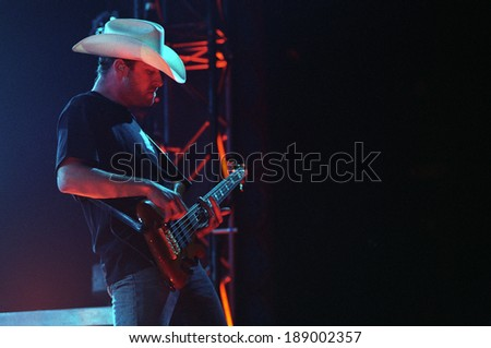 DENVER	MAY 14:	Bassist Mike Kroeger of the Heavy Metal band Nickelback performs in concert May 14, 2002 at the The Fillmore in Denver, C