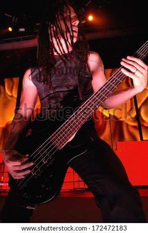 DENVER	OCTOBER 05:		Bassist John Moyer of the Heavy Metal band Disturbed performs in concert October 5, 2011 at the Comfort Dental Amphitheater in Denver, CO.