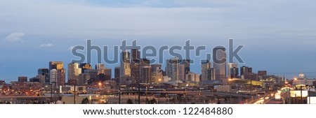 Denver. Panoramic image of Denver skyline at sunset. - stock photo