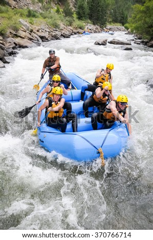 Denver, USA - July 11, 2010: A group of friends raft on Clear Creek near Denver, Colorado