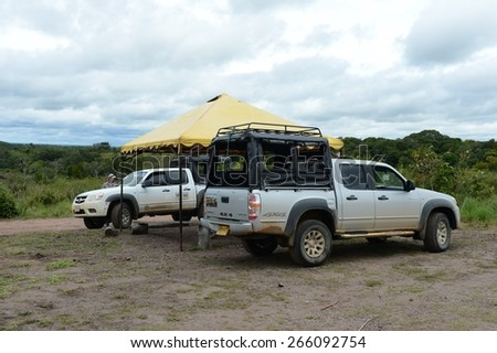 DEPARTMENT META, COLOMBIA - NOVEMBER 5, 2012: The cars of tourists Surrounding the river Guayabero. Guayabero's river in Colombia, after merge to Arjyari form  deep river Guaviare.