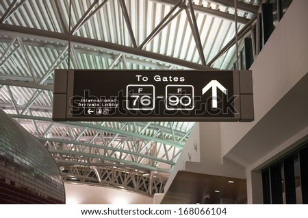 departure and arrival gates signs in airport - stock photo