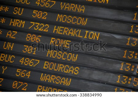 Departure/Arrivals  board at International Airport - stock photo