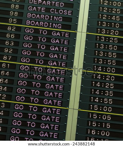 Departure board in airport  - stock photo