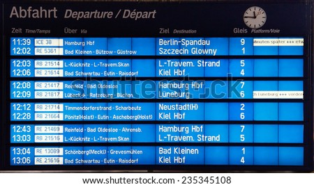 Departure board on the train station in Lubeck, Germany