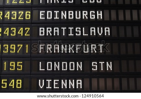 Departure schedule at an airport in Italy. Flights to Edinburgh, Bratislava, Frankfurt, London and Vienna. No airlines symbols visible. - stock photo