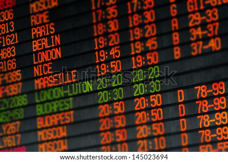Departures and arrivals electronic orange led schedule in airport - stock photo