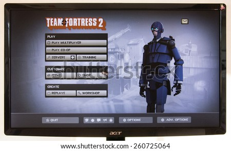 Depew, OK, USA - March 15, 2015: Blu MvM Spy Robot on starting screen of Team Fortress 2, a team-based first-person shooter multiplayer video game by Valve Corporation, released on October 10, 2007. - stock photo