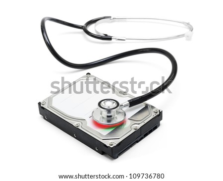 Depiction of computer repairs and digital data recovery with a stethoscope scanning for lost information on a hard drive disc isolated on white background - stock photo