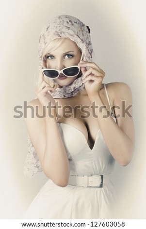 Depiction Of Vintage Womens Fashion Accessories With A Stunning Blonde Beauty Wearing Handkerchief And Sun Shades In Cool Style - stock photo