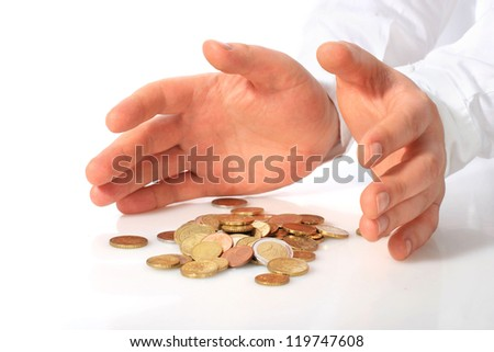 Deposit insurance. Hands and coins over white. - stock photo
