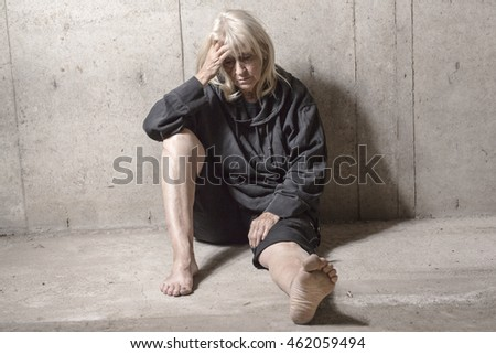 depress senior person with concrete background