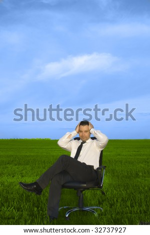 Depress young businessman sitting in the chair - stock photo