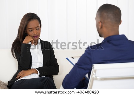 Depressed African American Woman At Psychiatrist Appointment - stock photo