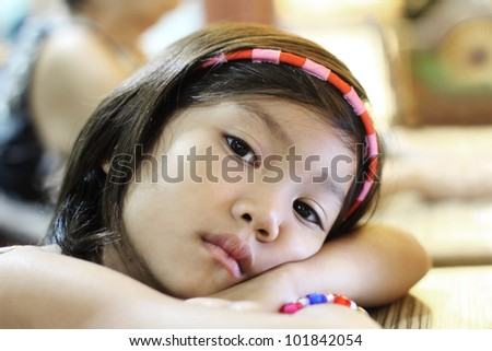 Depressed and lonely cute child - stock photo