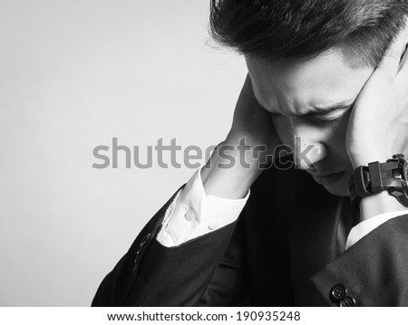 Depressed and stressed business man. - stock photo